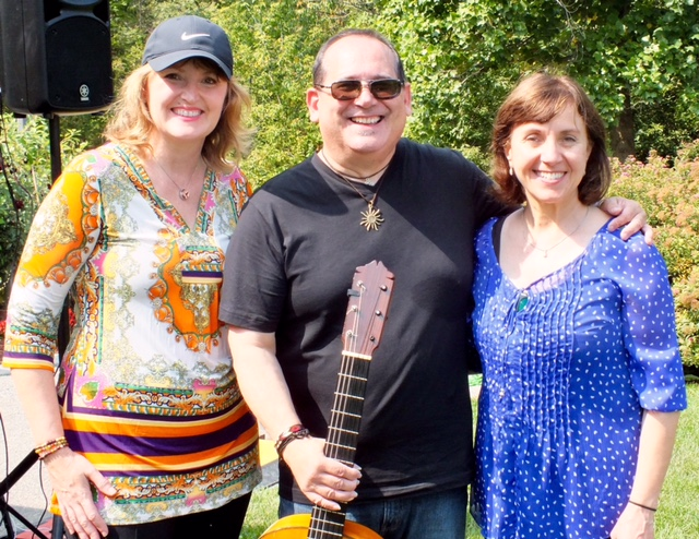 Lorne Park dental hygienist - Lori, musician - Mark Harry, Dr. Rosanna Fasciani pose for photo at VAM's Art in the Park 2017