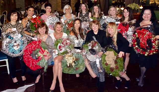 photo of entire Lorne Park Dental team holding wreaths at 2017 holiday party