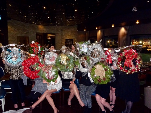 fun group photo of Lorne Park Dental team holding up their holiday wreaths