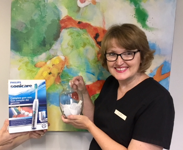 Lorne Park Dental Hygienist Lori draws winning Lorne Park Dental Associates Art in the Park 2018 Raffle ticket