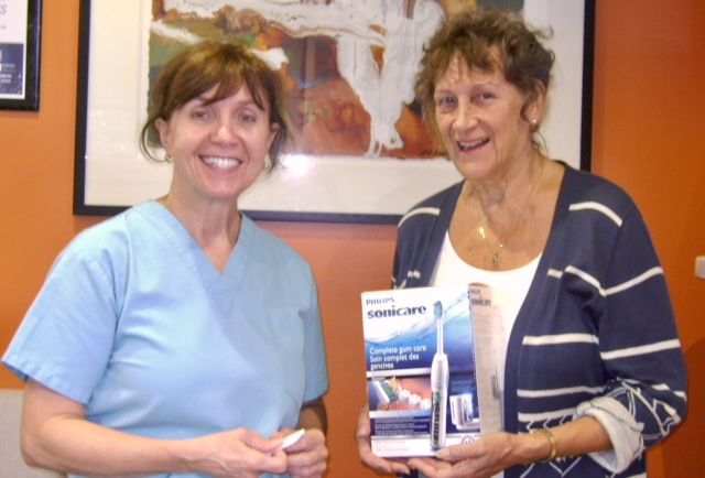 Lorne Park Dental Associates Art in the Park Raffle winner, Carol with Dr. Fasciani