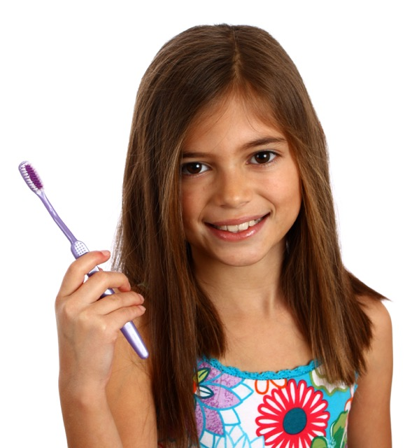 smiling girl holding toothbrush